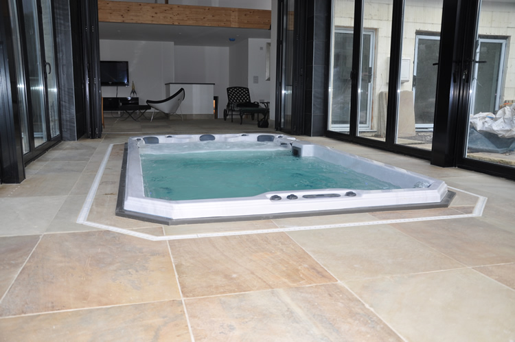beautiful-installation-of-swim-spa-in-home