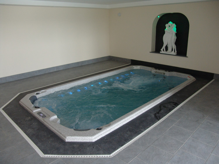 indoor-installation-of-swim-spa-with-lights-and-water-on