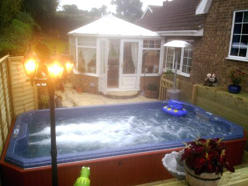 swim-spa-in-backyard-with-jets-on