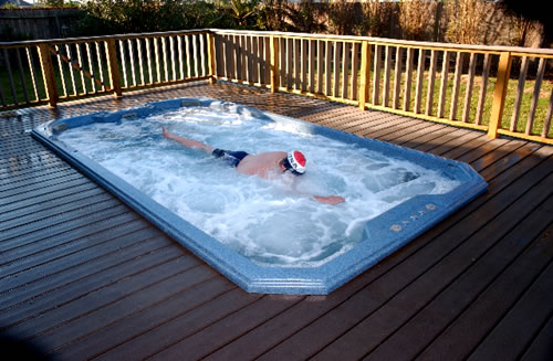 swim-spa-in-deck-swith-man-swimming-against-the-water