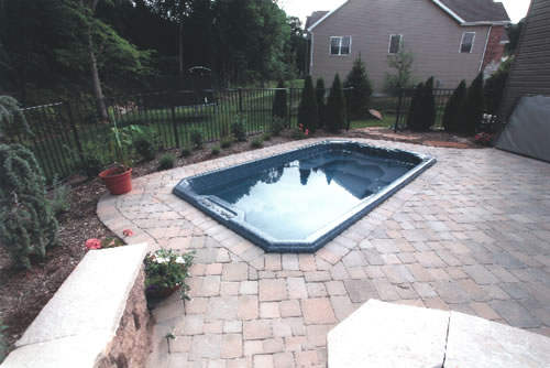 swim-spa-inground-install-with-stone-brick-surrounding