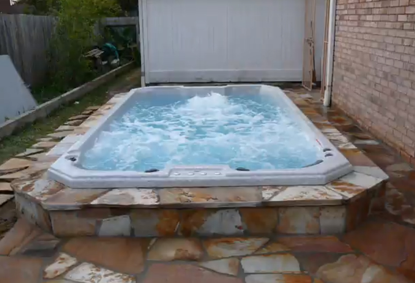 swim-spa-inground-installation-with-rock-tile