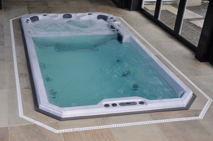 swim-spa-installed-in-home-turned-on-with-lights