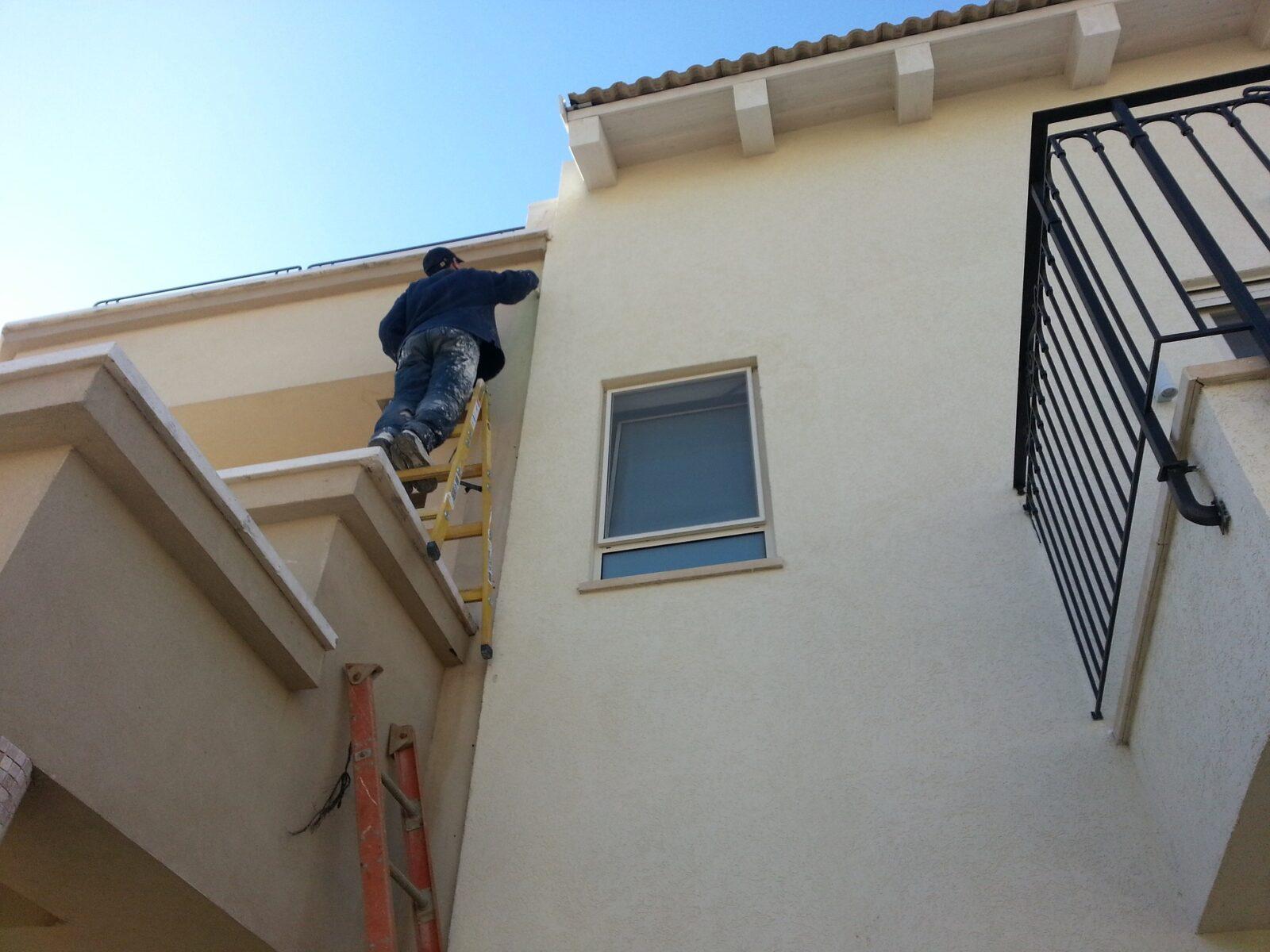 MI plumber fixing a kitchen drain