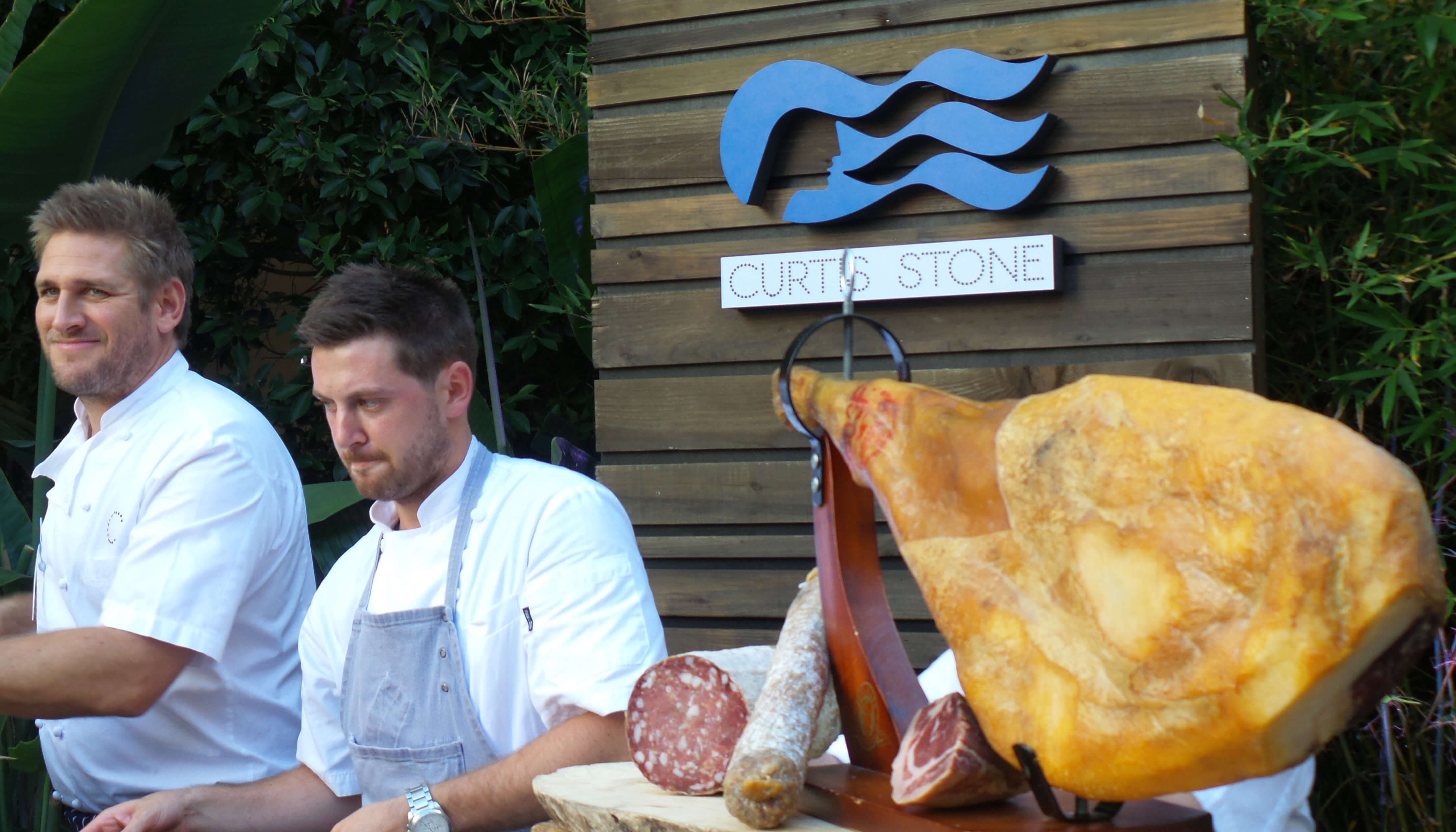 Chefs Curtis and Christian serve the charcuterie items.