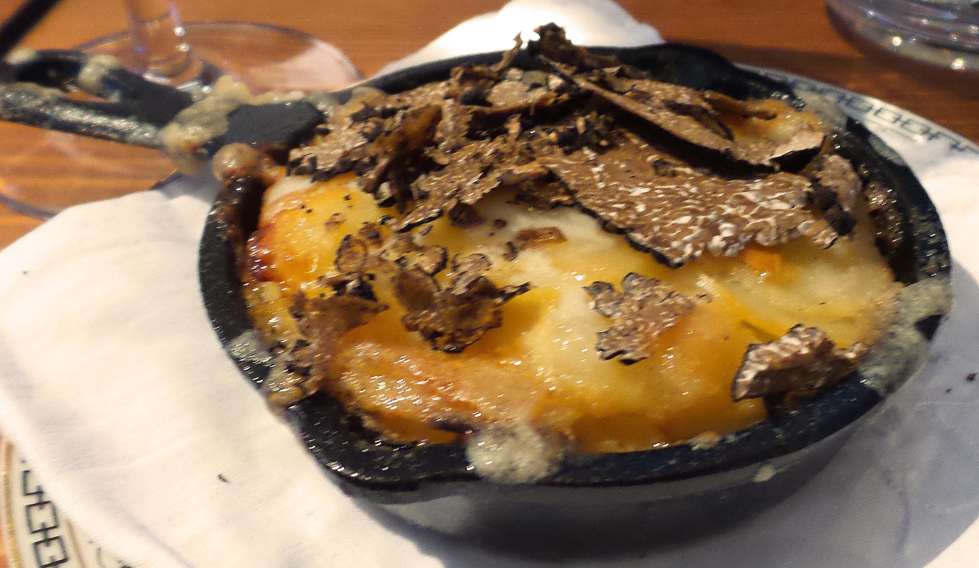 Potato Gratin--Truffles, cream.