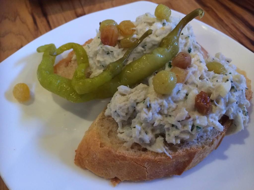 crab salad, creme fraiche, lemon and muscat-soaked raisins
