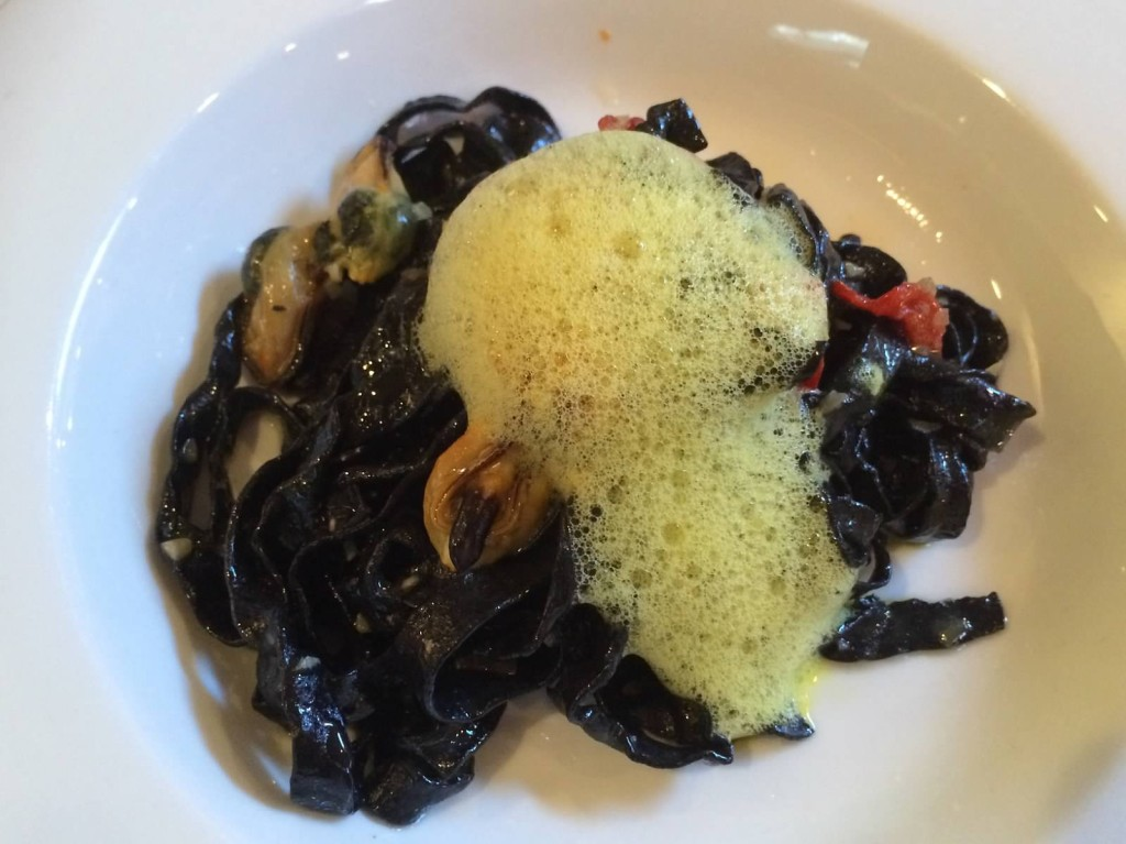 House-made squid ink pasta, mussels, piquillo peppers, saffron foam