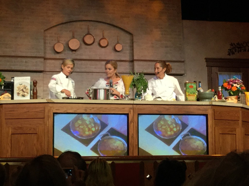 Cat Cora and Suzanne Tracht aboard the Ruby Princess hosting a food demonstration.