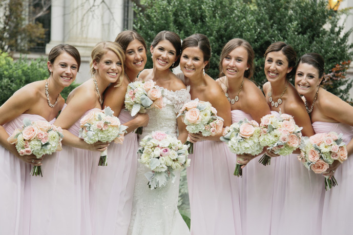 beautiful bridal party with bride in pink dresses