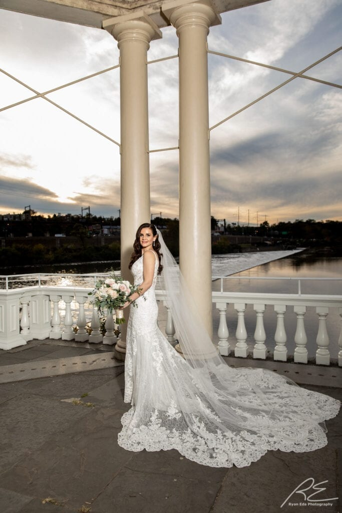 beautiful bride at Waterworks in Philadelphia with Hollywood hair and makeup