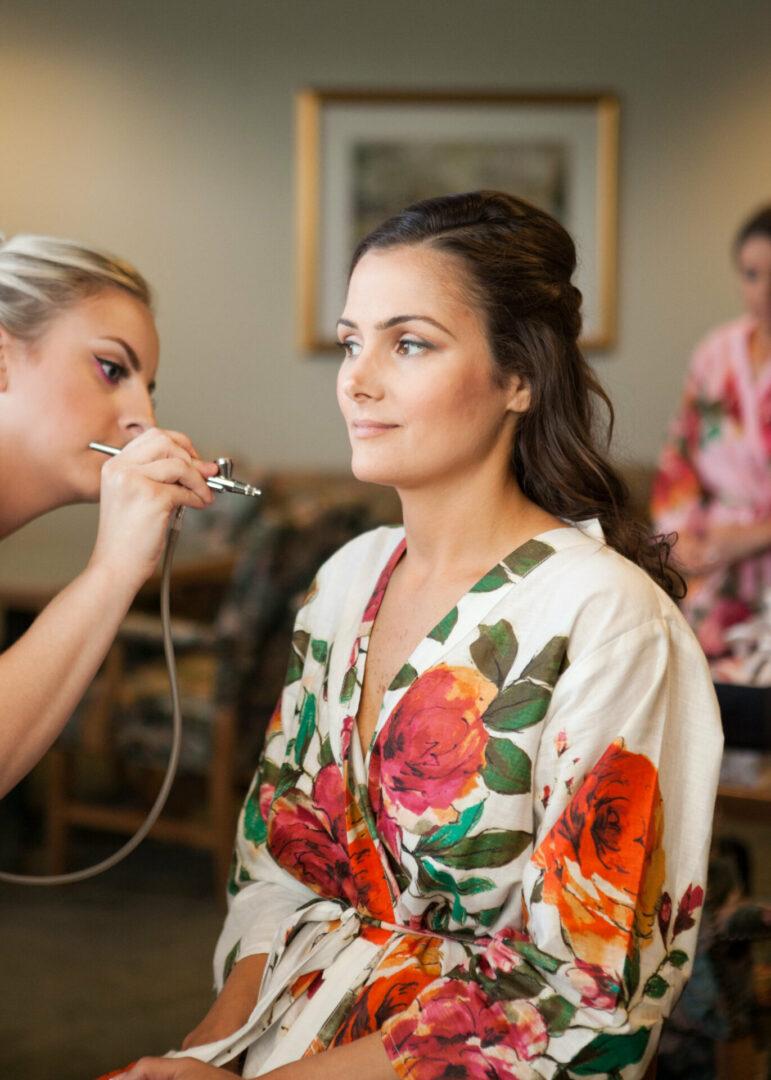 bride getting airbrush makeup