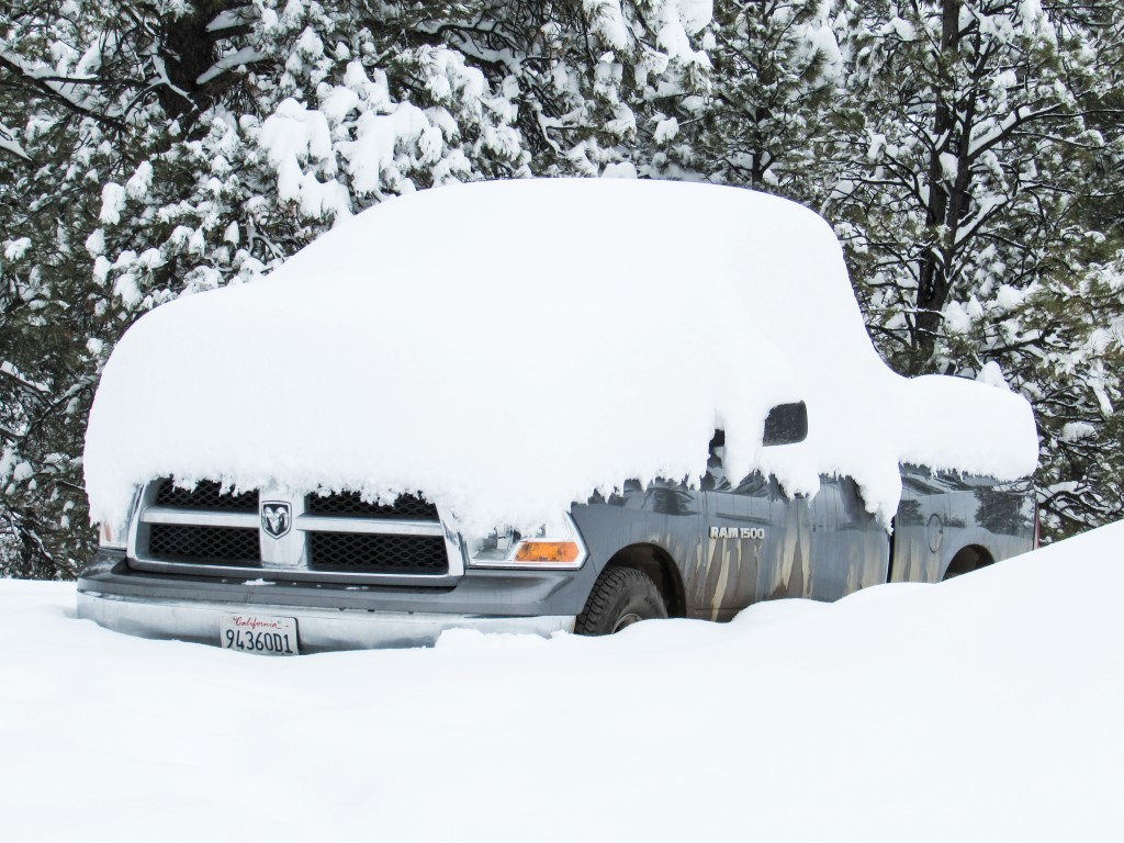 Snow covered vehicle