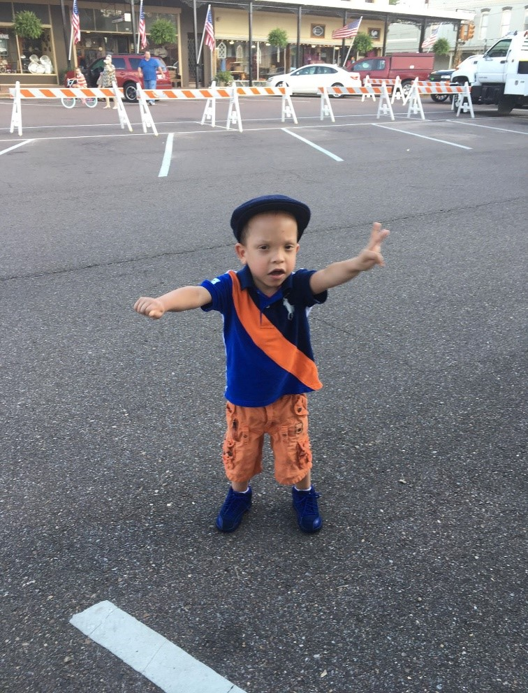Elias walking down the street in the recent Founder's Day Parade in Holly Springs