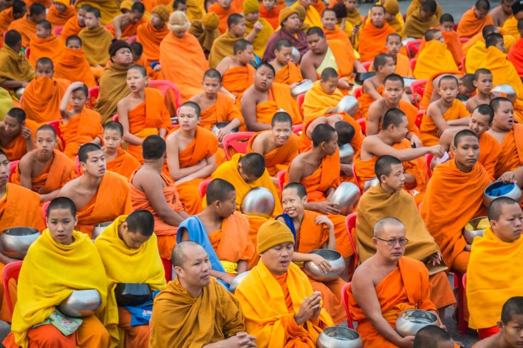 From Gianni: This was taken recently in Chiang Mai. Every year 10,000 monks from all over Thailand come to the city for a spectacular ceremony where they collect offerings from the crowd. The ceremony starts early in the morning. In this picture the monks are waiting for the ceremony to start.