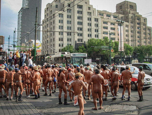 From Cassie: I came upon this rather surprising crowd in Mexico City back in 2007. A group of nude, male farmers from the State of Veracruz were blocking traffic to protest a land-use decision made by a corrupt local politician. They were wearing the elected official's face as a loincloth. Just another morning in Mexico City!