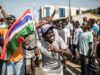 "A man waves a Gambian flag as he celebrates the victory of Gambia's opposition candidate Adama Barrow during the Presidential Elections on December 2, 2016, in Serekunda, Banjul.The impoverished west African nation of Gambia is set for a rare handover of power after long-serving President Yahya Jammeh suffered a shock defeat at the polls. Rights bodies and media watchdogs accuse Jammeh of cultivating a ""pervasive climate of fear"" during his 22 years in office and of crushing dissent against his regime. / AFP / MARCO LONGARI        (Photo credit should read MARCO LONGARI/AFP/Getty Images)"
