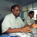 (FILES) In this file photo taken on November 10, 1999 AFP correspondent in Gambia Deyda Hydara (front) works next to AFP correspondent in Mauritania Hademine Ould Sady (R) during a training at the AFP office in Dakar, Senegal. - A Gambian army officer accused ex-President Yahya Jammeh of ordering the 2004 murder of an AFP correspondent Deyda Hydara and said he was one of three involved in the killing, according to his testimony to a truth commission on July 22, 2019. (Photo by Seyllou / AFP)