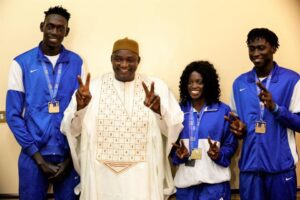 Barrow gifts plots of land to Gina Bass and other athletes after African Games success