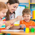 depositphotos_46644109-stock-photo-cute-children-drawing-with-teacher