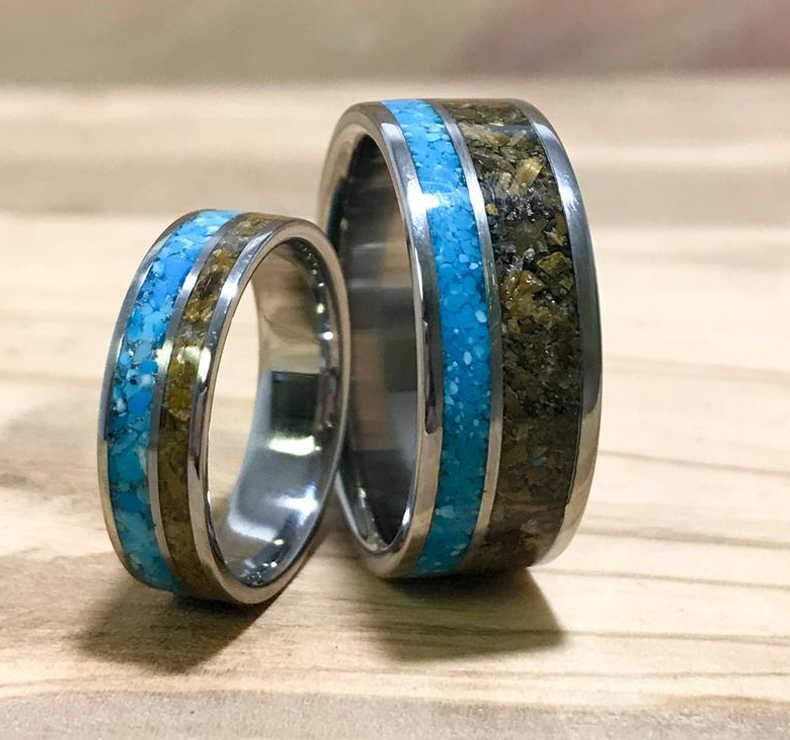 a pair of turquoise wedding rings