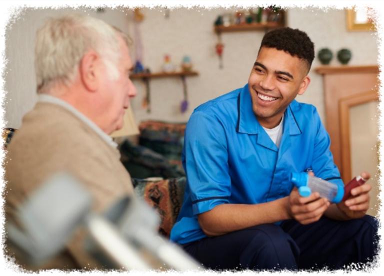 elderly man with male caregiver