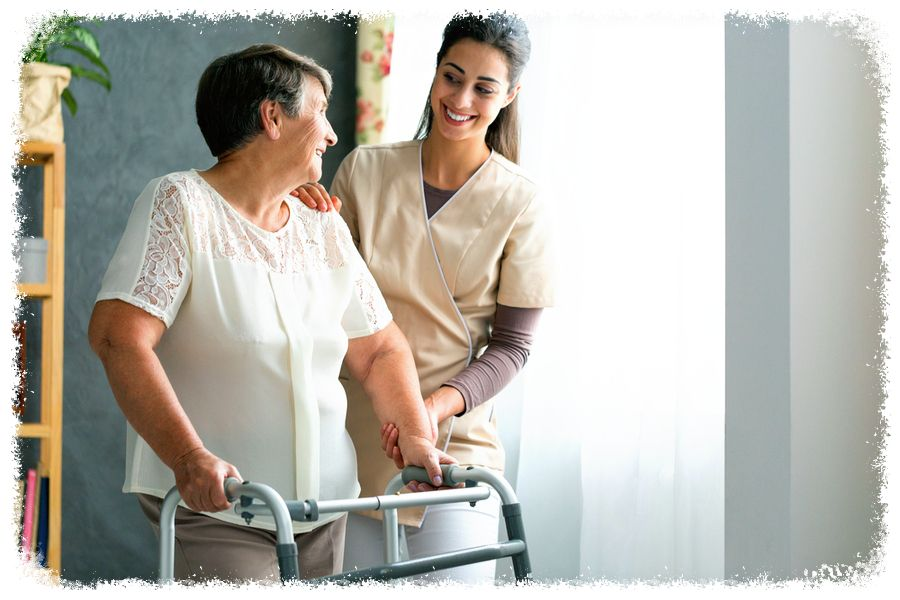 Elderly woman being assisted to walk
