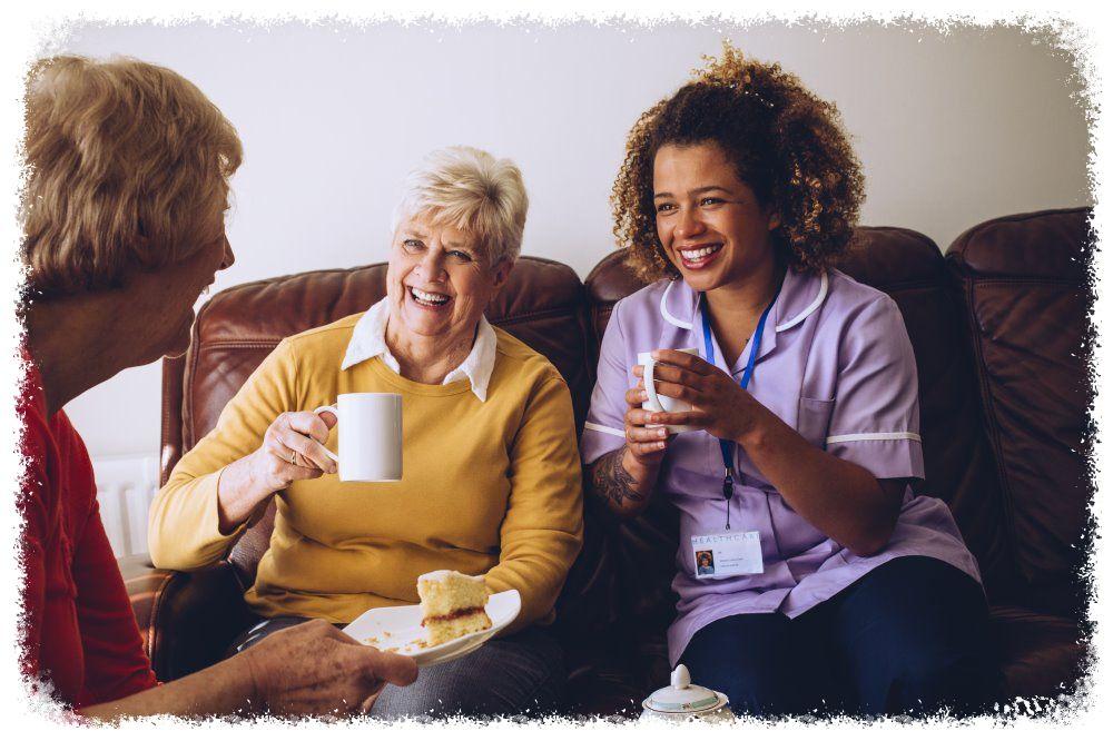 elderly friends with caregiver