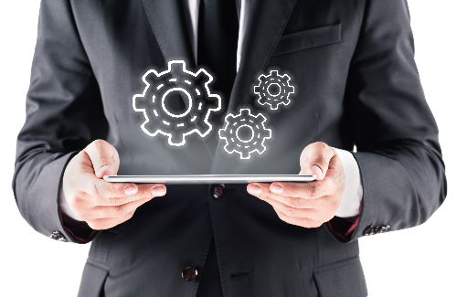 Man holding tablet computer with gear icons
