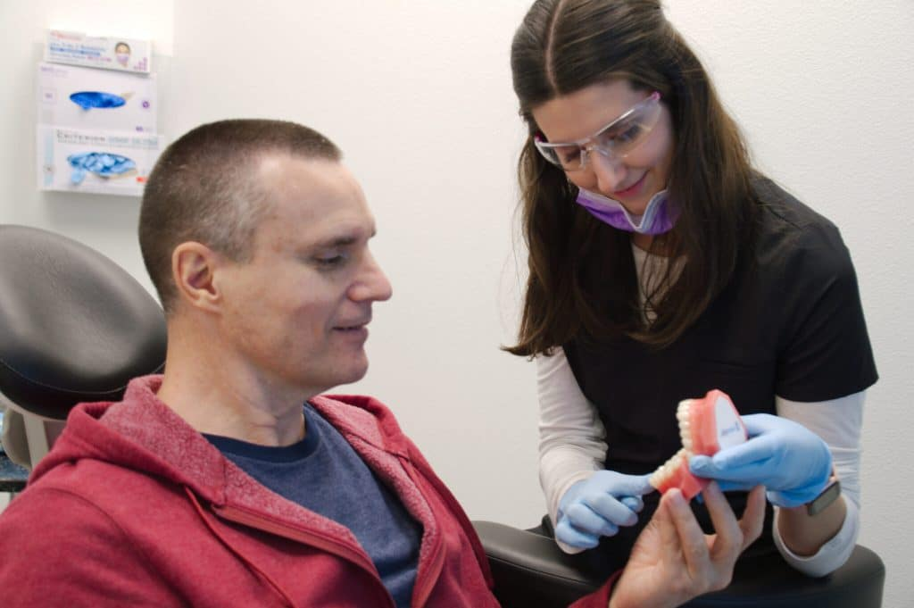 Showing Dental Implants Model to Patient, Cosmetic Dentistry, Z Dentistry, Fort Worth TX