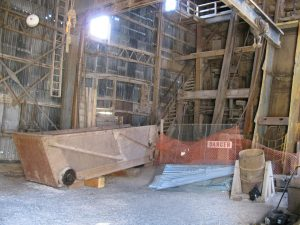 The inside of the shafthouse shows the large materials car lowered.
