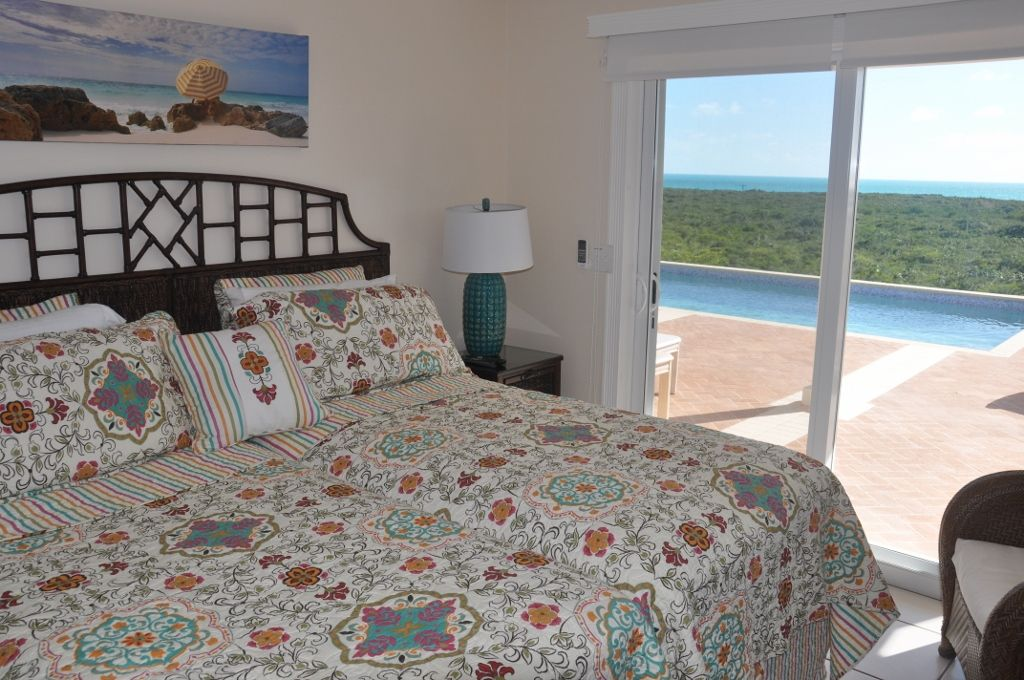 King size bedroom with walk out to pool
