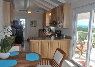 Second floor dining room and kitchen with spectacular views