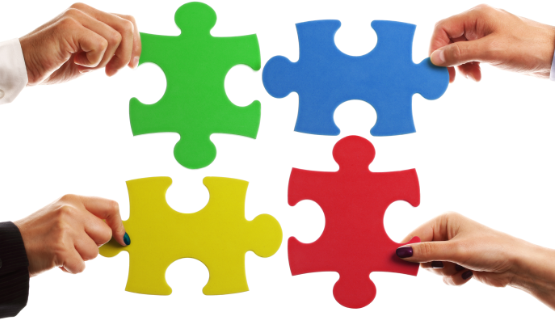 hands putting 4 puzzle pieces together