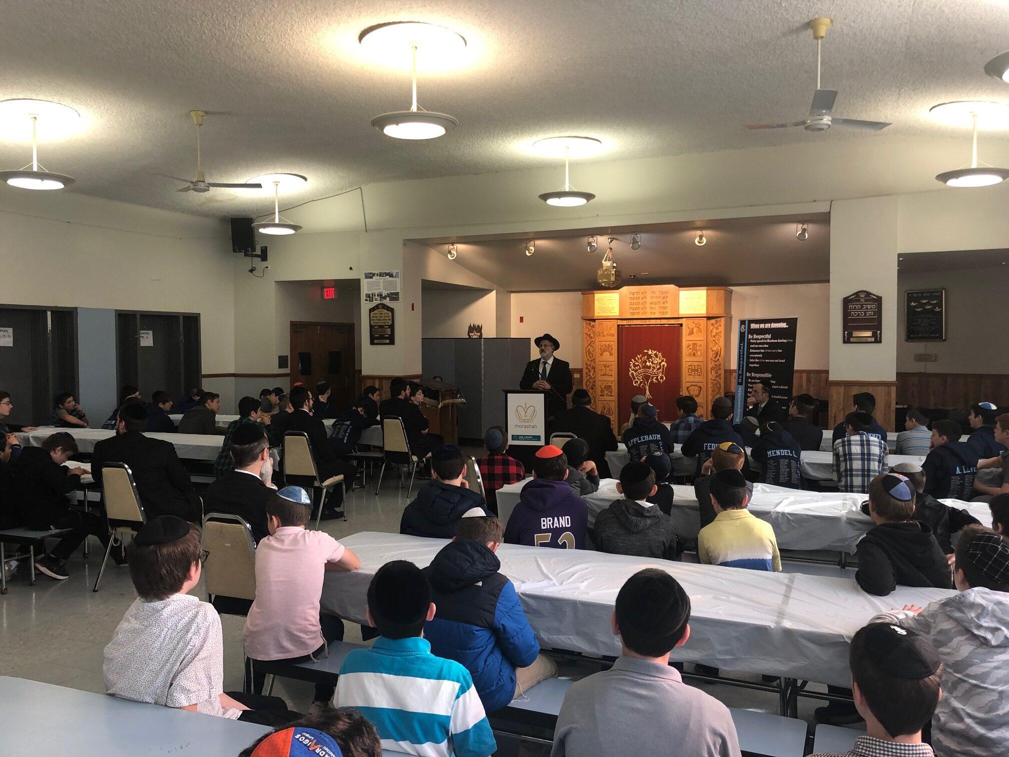 "Harav Daniel raccah speaking at Arie Crown Hebrew day school and Yeshiva Tiferes Tzvi about Chacham Ovadia Yosef ZT""L Ovadia Yosef ZT""L"