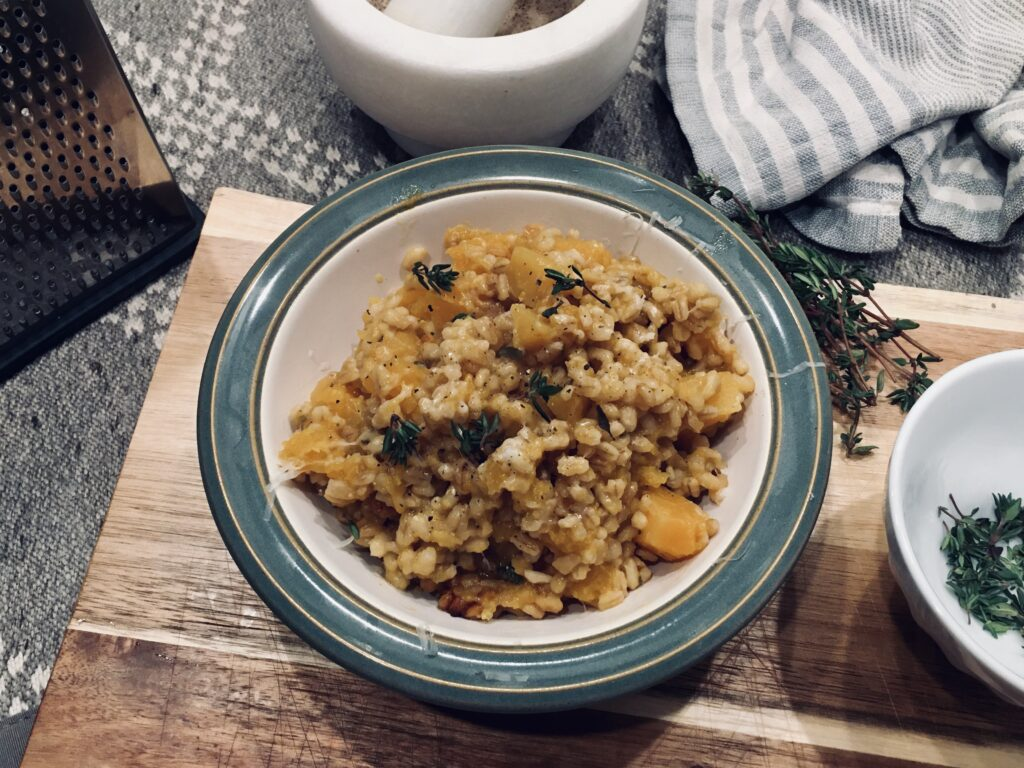 staged setting of cooked barley and butternut squash