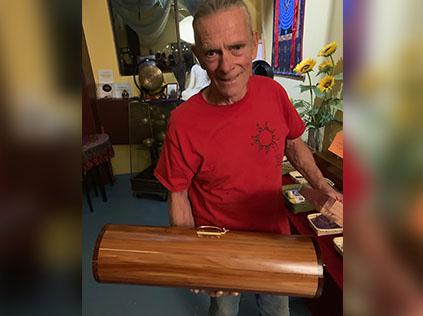 Tom with round cedar box