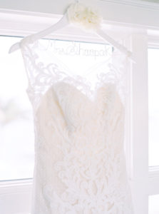 Ivory Lace Wedding Dress on White Personalized Wedding Hangar with Ivory Floral Accent   Clearwater Beach Wedding Planning by Parties a la Carte