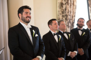 Groom Wedding Ceremony Portrait in Black Tuxedo with Ivory Bowtie