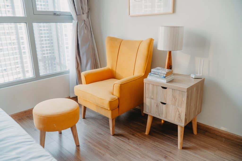 easiest items to flip for a profit furniture. Image of yellow furniture in a condo
