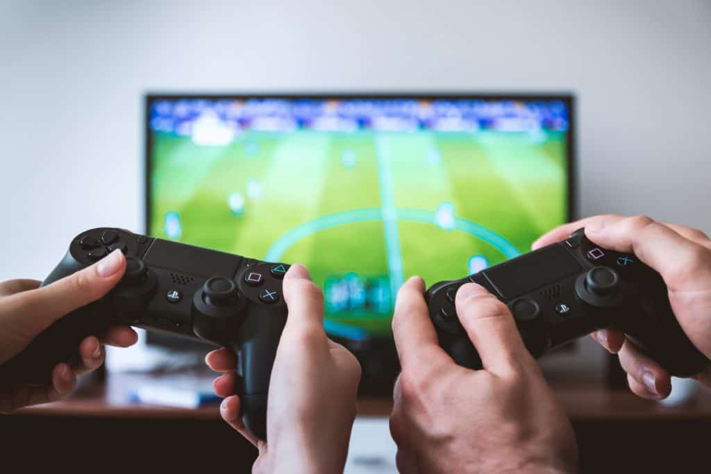 easiest items to flip for a profit video games. Image of video game consoles and television.