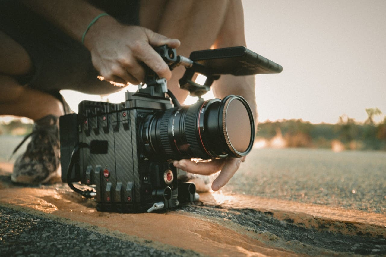 hobbies that make money - filming - person filming with a professional camera on set