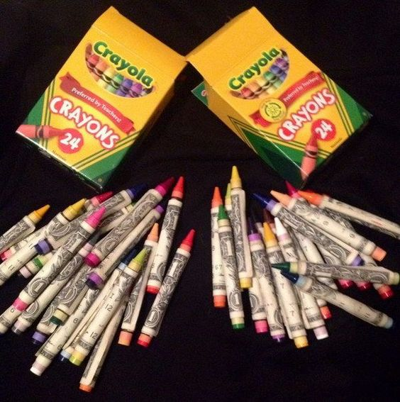 money wrapped around crayons