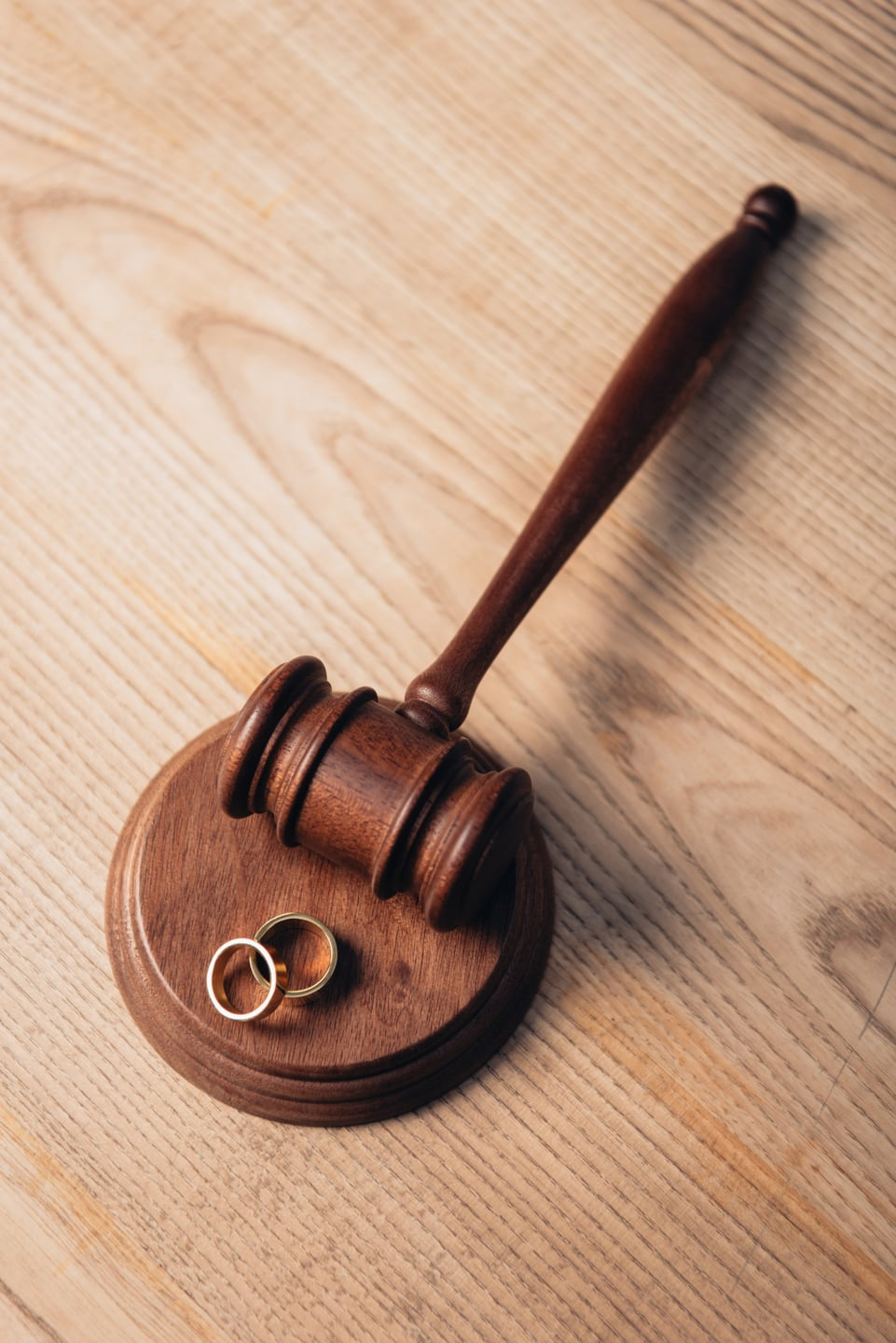 Family Lawyers Gavel and wedding bands
