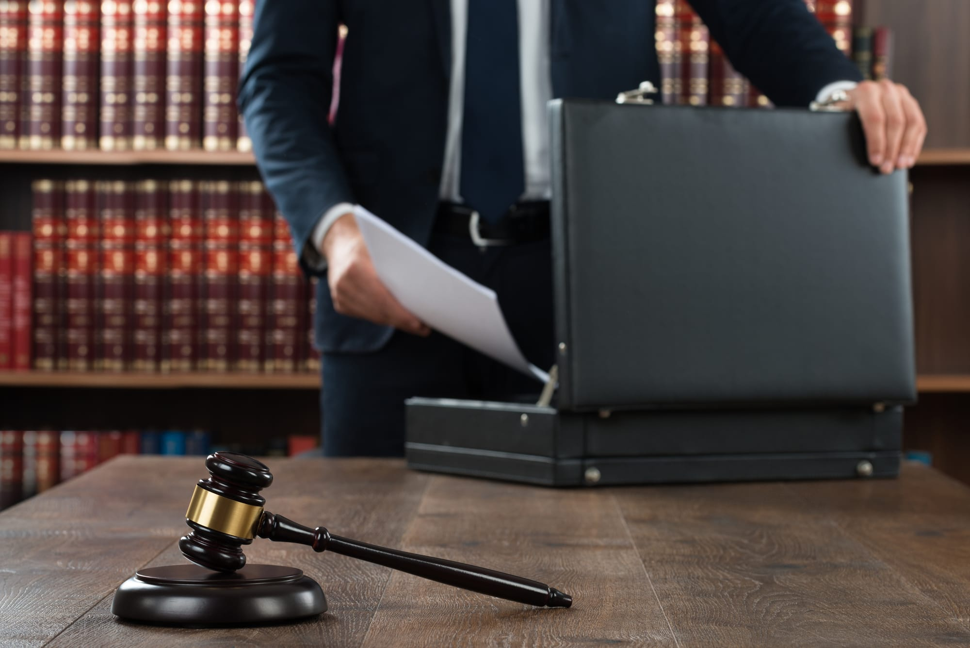 Business Lawyer collecting documents into a briefcase