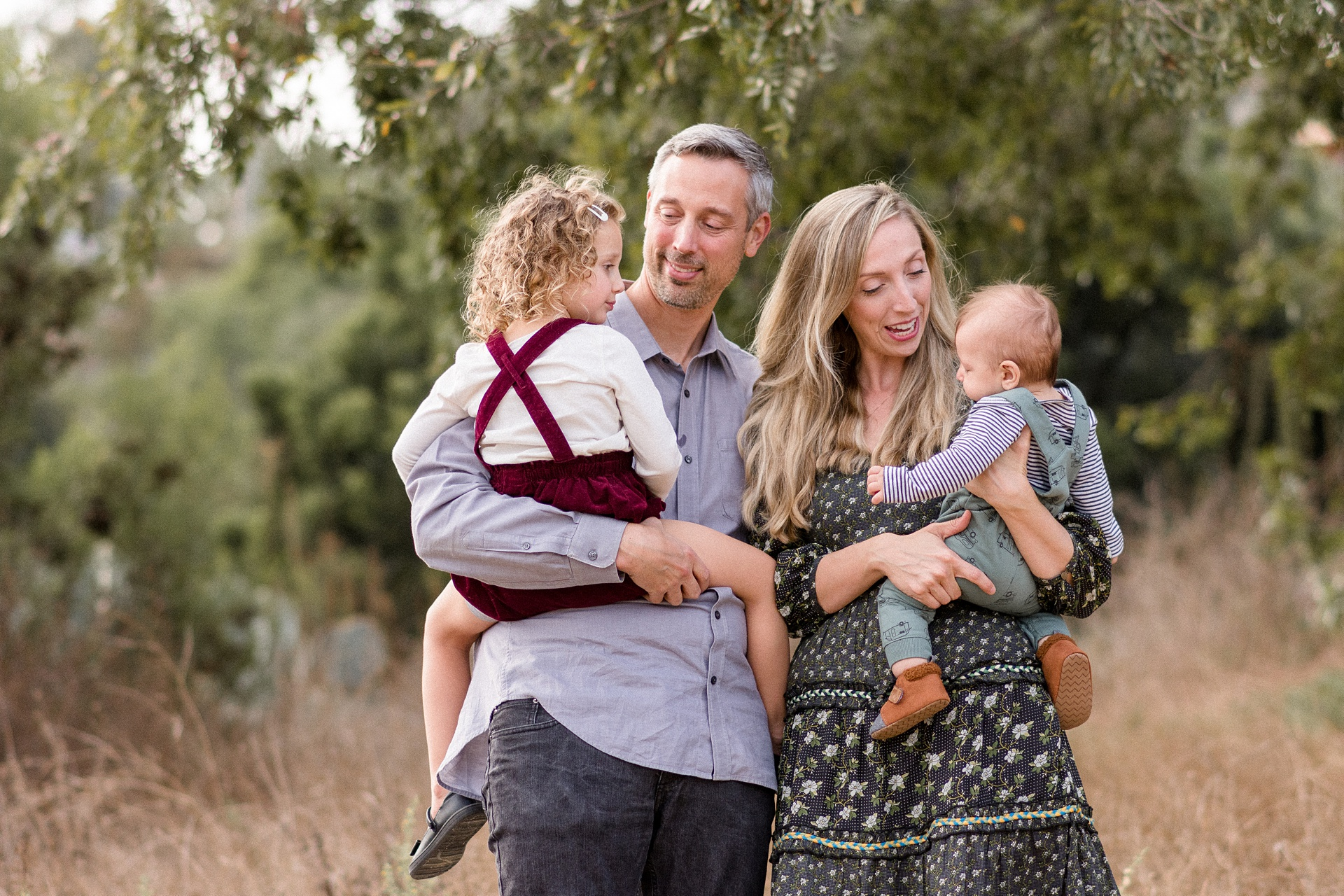 San Diego Family Photo Parents holding little girl and baby boy