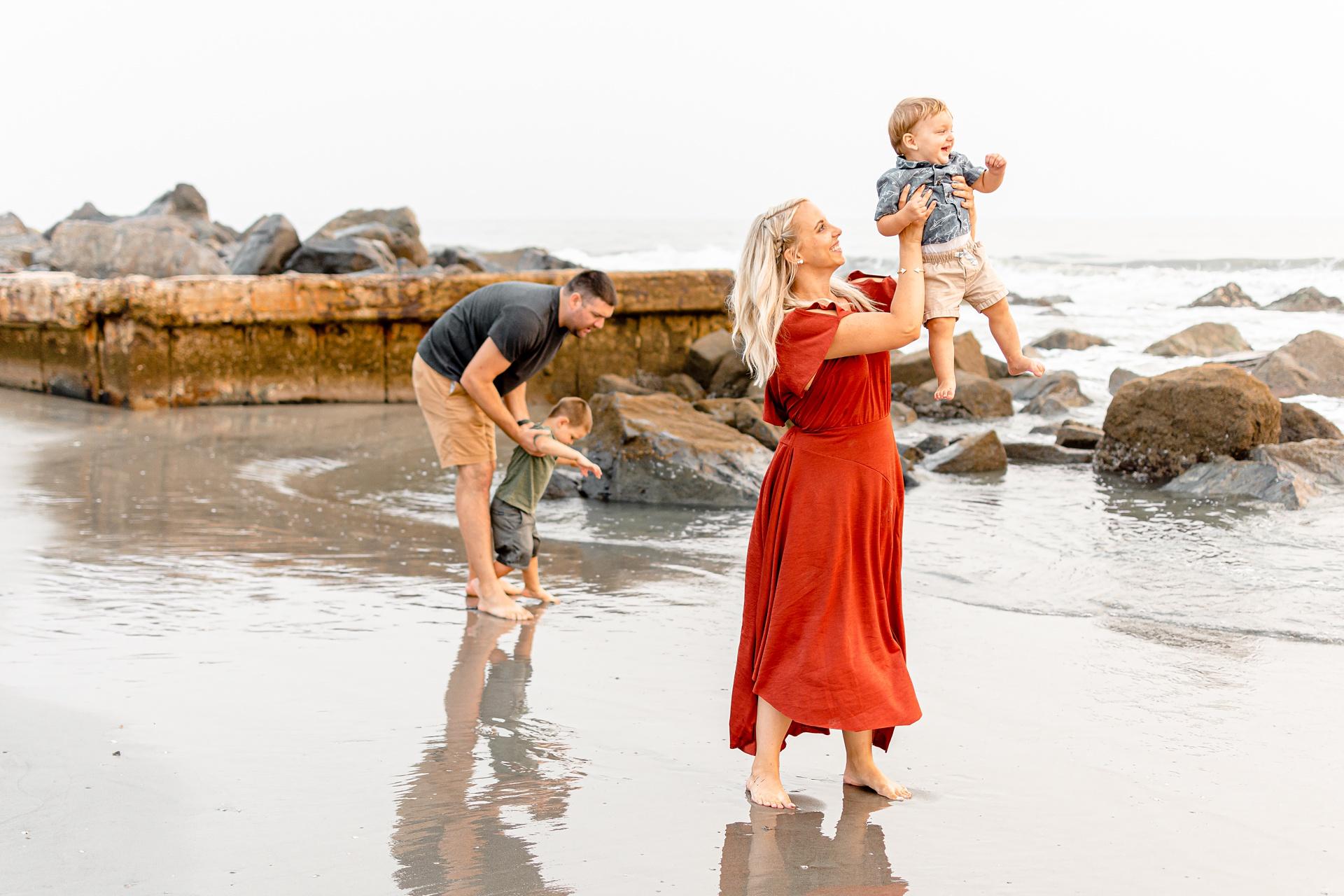 San Diego family with two kids playing on Coronado beach