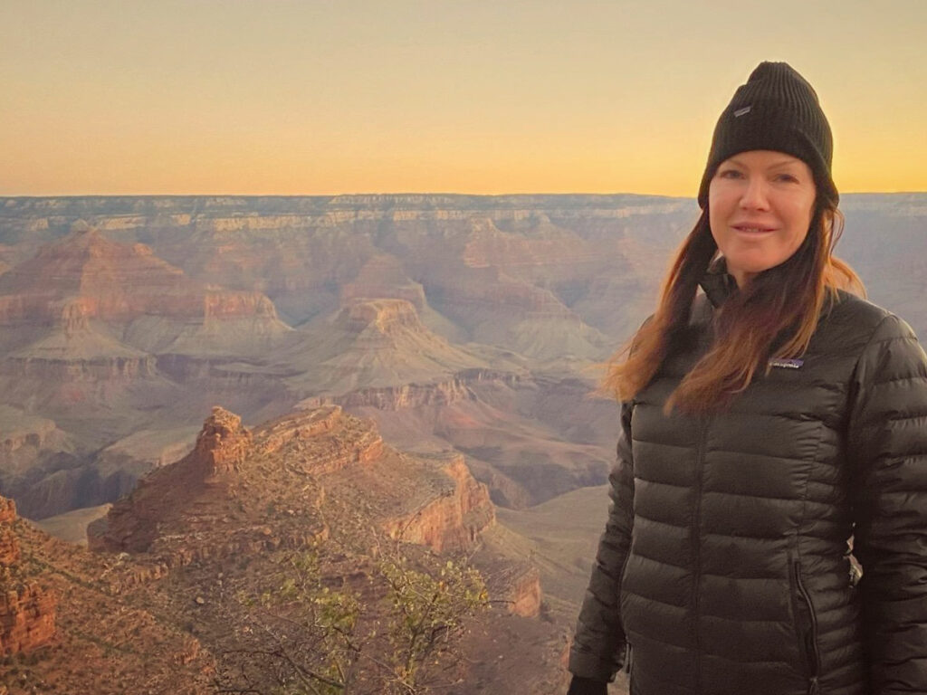 Kira Reed Lorsch looking over the rim of the Grand Canyon