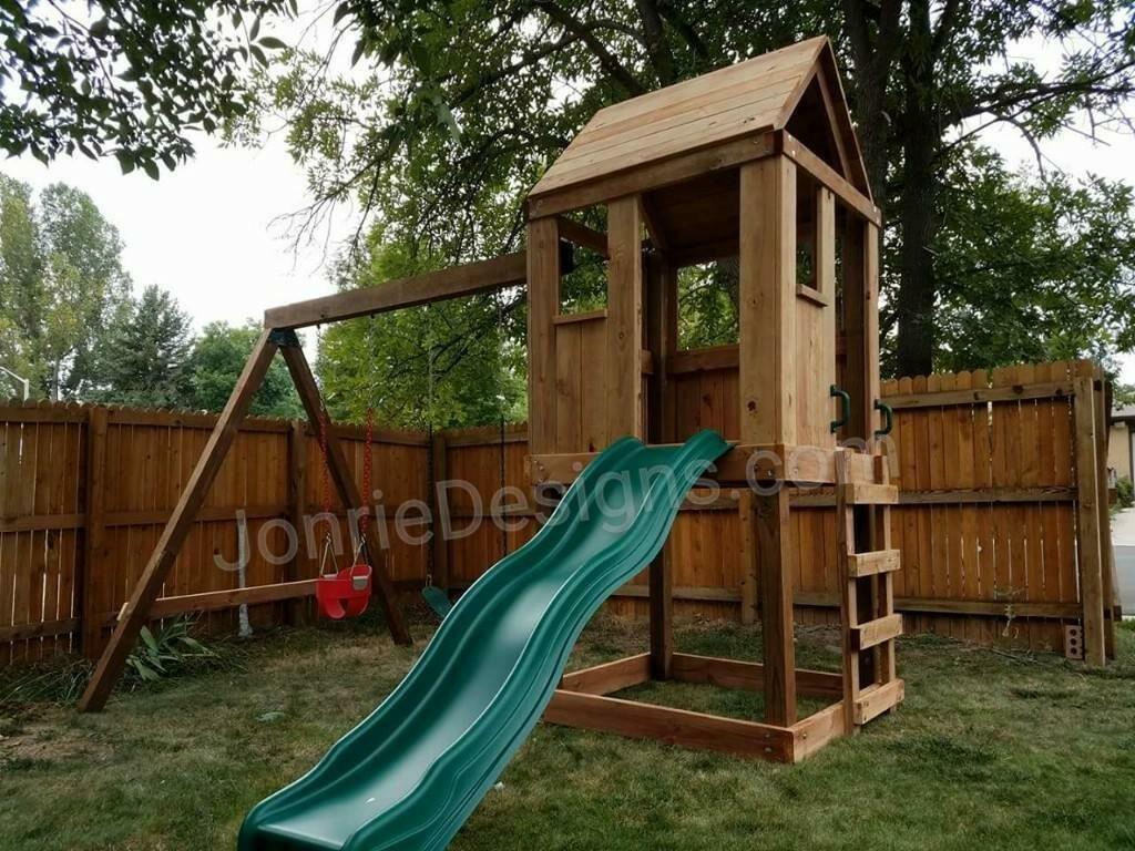 4'x4' Clubhouse with wooden roof, 4' Deck height, Standard slide, Ladder entry, 8' Swing beam with 1 Standard swing & 1 Red Bucket Swing