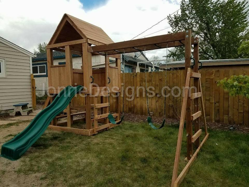 5'x5' Clubhouse with wooden roof, 4' Deck height, 4' Standard slide, Rock wall entry, Picnic Table, 8' Monkey bars with dual ladders & 2 Standard swings